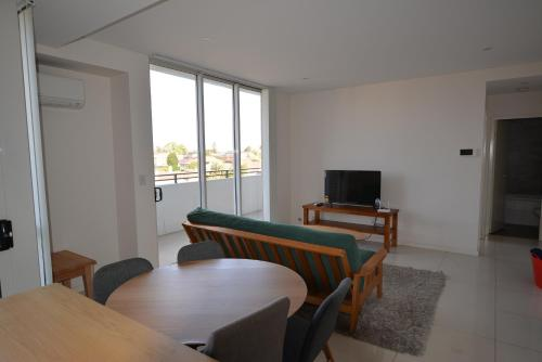 A television and/or entertainment center at Large one bedroom in Burwood centre