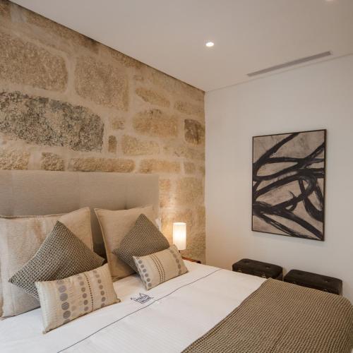 Uma cama ou camas num quarto em Porto Deluxe Guesthouse