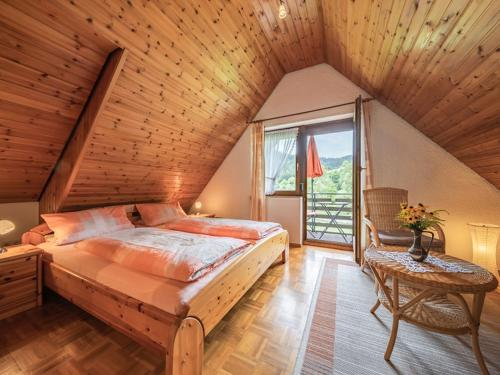 A bed or beds in a room at Kornbauernhof