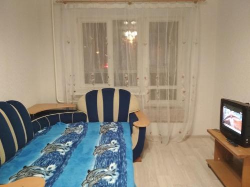 Кровать или кровати в номере Apartment on Oktyabrya 116