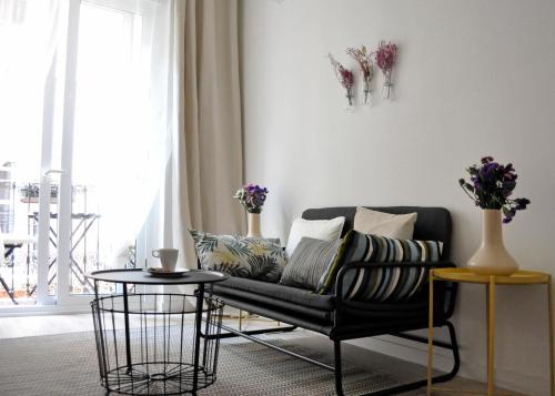 A seating area at Apartment Muñoz 1