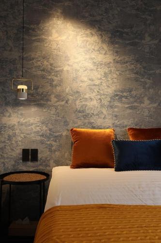 元飯店(Moto Hotel)房間的床