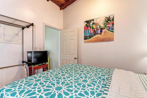 A bed or beds in a room at Inn At The Beach Units