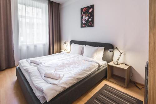 Gulta vai gultas numurā naktsmītnē Bearsleys Archers Apartments