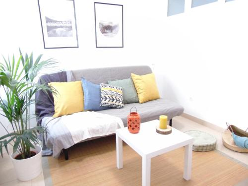 A seating area at Las Canteras Flat III by Canary365