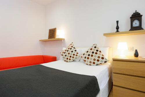 A bed or beds in a room at King's Cross Central Apartments