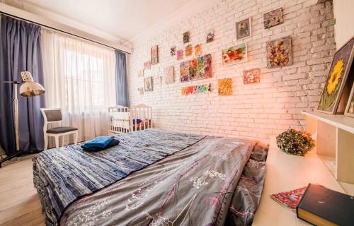 Кровать или кровати в номере Art Flat in the center of Minsk