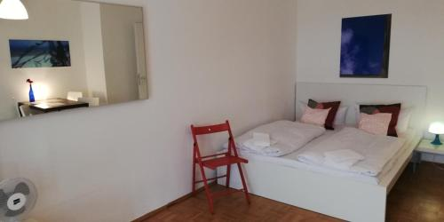 A bed or beds in a room at Berlin Holiday Apartments near Central Station