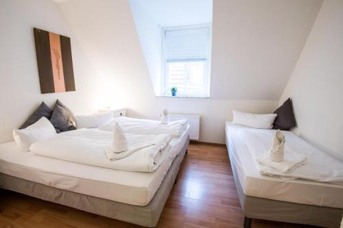 A bed or beds in a room at Appartementhaus Obertrave