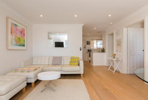 A seating area at Cottesloe Beach Pines Apartment