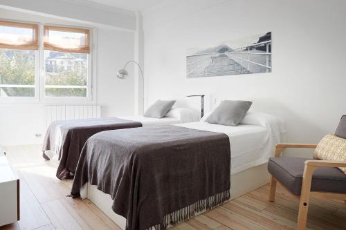 Łóżko lub łóżka w pokoju w obiekcie Soroa Apartment