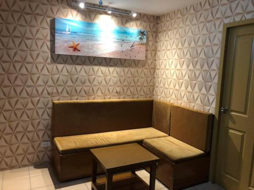 A seating area at Cozy Condo Unit within Metro Manila