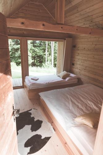 Postelja oz. postelje v sobi nastanitve Razgledi z Vrha