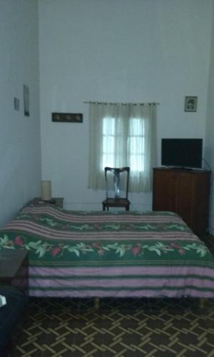A bed or beds in a room at LA ESQUINA DEL SOL