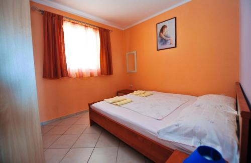 A bed or beds in a room at Apartment Danka