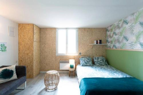 A bed or beds in a room at Le So Green