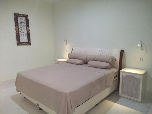 A bed or beds in a room at Bali Paradise Suites