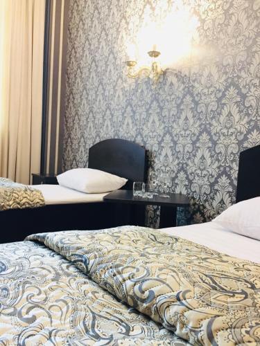 Кровать или кровати в номере Hotel Sofia
