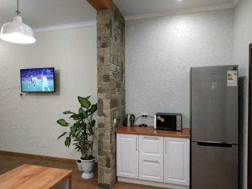 A kitchen or kitchenette at Comfortable Apartment in the Center