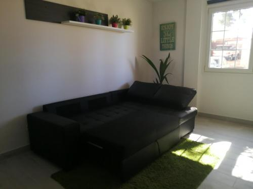 A seating area at TRANQUILIDAD, MAR Y SOL!