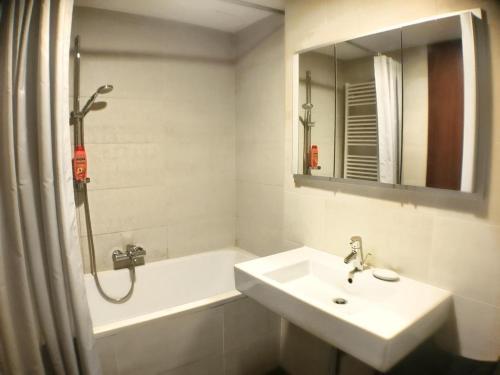 Ванная комната в ROSEWIND Apartments - Pitterova