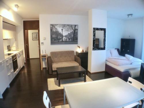 Гостиная зона в ROSEWIND Apartments - Pitterova