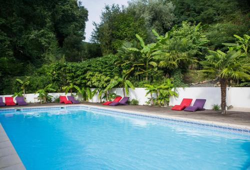 The swimming pool at or near Les Collines Iduki