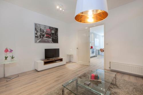 A television and/or entertainment center at Luxury Amsterdam City Center Apartments