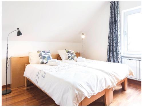 Ein Bett oder Betten in einem Zimmer der Unterkunft Eight-Bedroom Holiday Home in Krizevci pri Ljutomeru