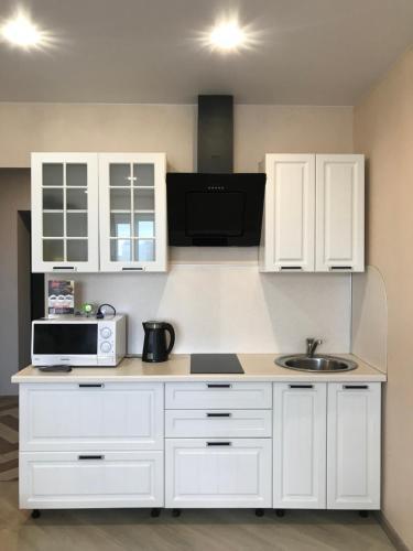 Кухня или мини-кухня в Центральные Апартаменты