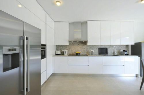A kitchen or kitchenette at Montagnola Apartment Sleeps 10 Pool Air Con