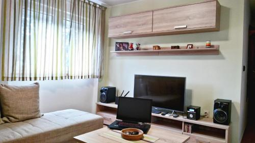 A television and/or entertainment centre at Apartment Romina