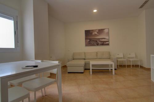 A seating area at Apartamentos Centro 2 el Puerto
