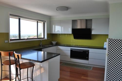 A kitchen or kitchenette at lake and ocean view