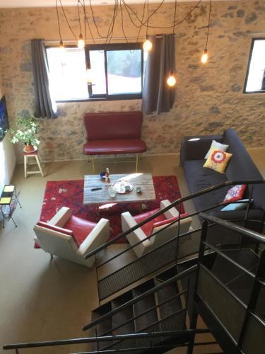 Télévision ou salle de divertissement dans l'établissement Chez Les Brocs
