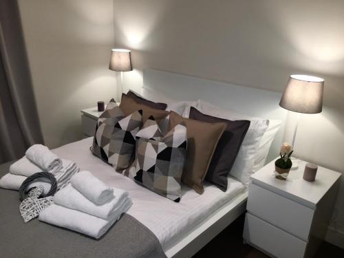 Cama o camas de una habitación en Deluxe Apartment in Central London Camden