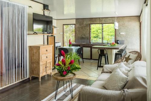 A kitchen or kitchenette at Matira Sunset House