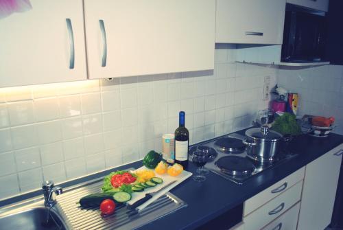 Kuchyň nebo kuchyňský kout v ubytování Aparthotel AXL Flathotel Continental Stay