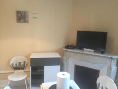 A television and/or entertainment center at Studio thermes callou