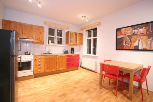 A kitchen or kitchenette at A Part of Reykjavík Apartments - Vesturgata