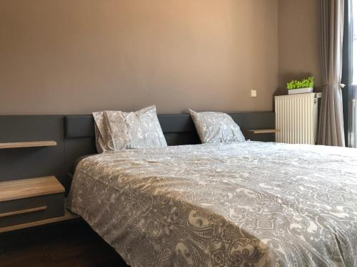 A bed or beds in a room at Modern apartment in the heart of Belval