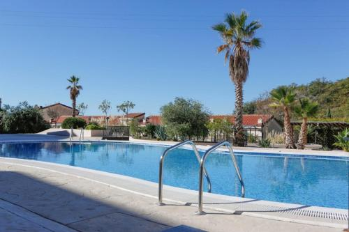 The swimming pool at or near Luxury Pool Apartments near the sea