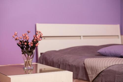 A bed or beds in a room at Stylish Apartment Plovdiv II