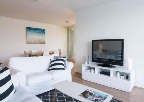 A television and/or entertainment center at ABSOLUTE WATERFRONT UNIT