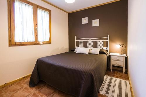 Cama o camas de una habitación en Apartamentos Turisticos Matagacha