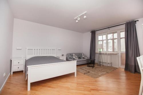 Ліжко або ліжка в номері Korali Apartment
