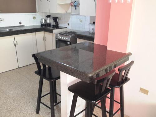 A kitchen or kitchenette at Riveri Salinas 9