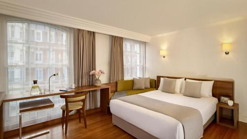 A bed or beds in a room at Citadines South Kensington London