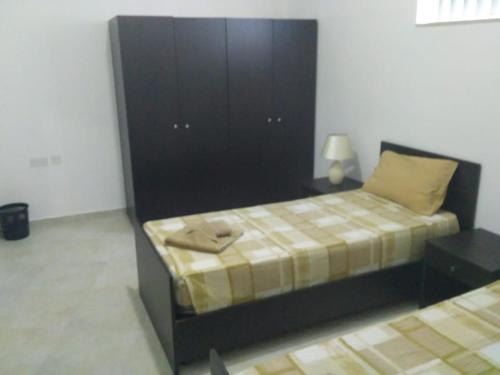 A bed or beds in a room at 5-Senses