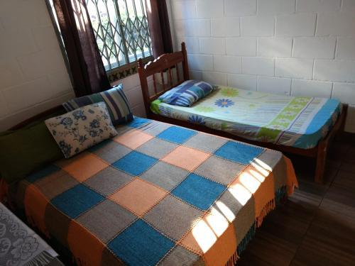 Cama o camas de una habitación en Casa do Parque Burle